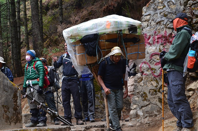 Porters Carrying Supplies