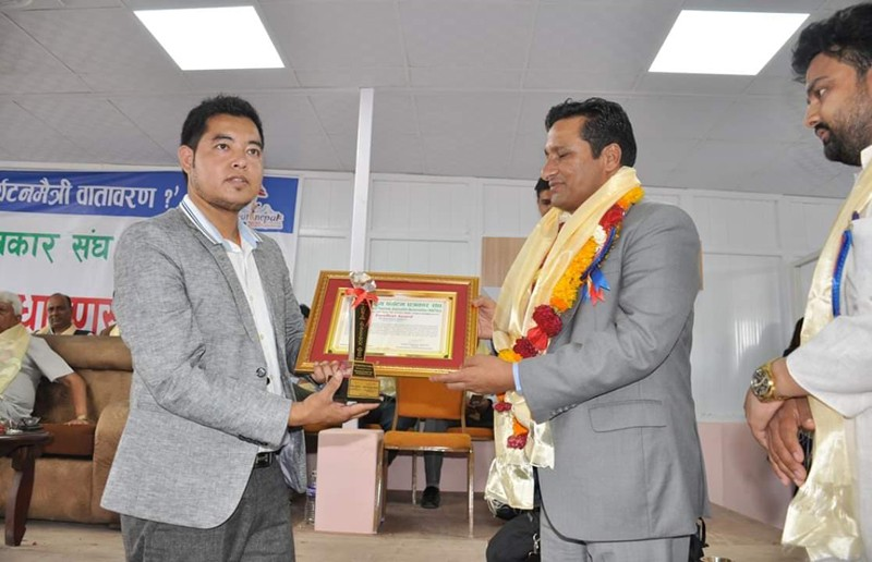 Receiving Award By Ramkrishna Timalsina