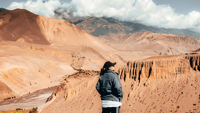 Solo Backpacker Enjoying the Views in Mustang