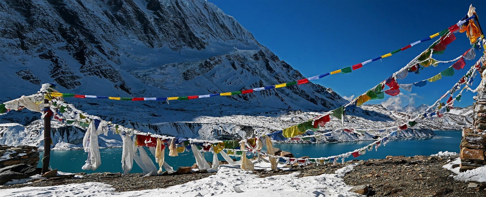 Tilicho Lake and prayer flags